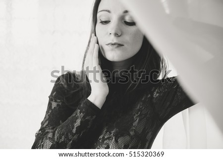 Portrait of sensual woman on light window background