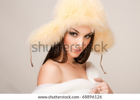 Portrait of sensual woman with furry hat, studio isolated shot