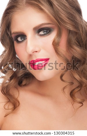 Portrait of sensual young woman with stylish bright makeup and long curly hair. Isolated on white background
