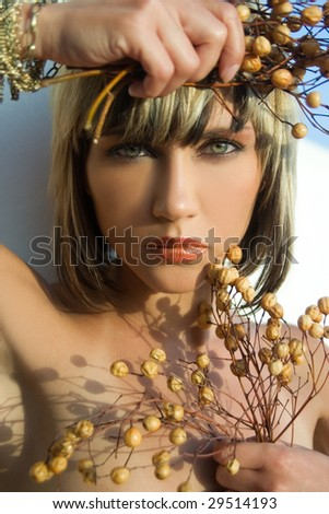 Portrait of sensual young woman with yellow berries - stock photo