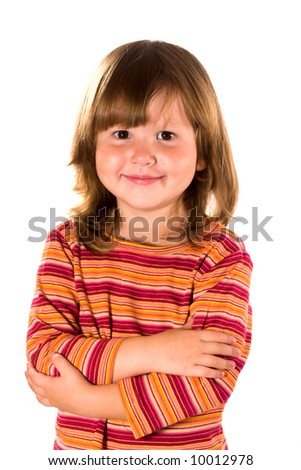 Portrait of serene little girl looking at you with kind smile - stock photo