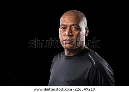 Portrait of serious Brazilian footballer looking at the camera - stock photo