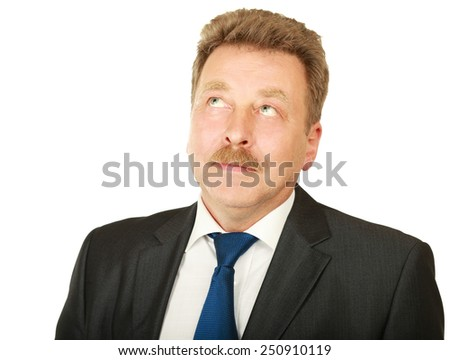 Portrait of serious businessman looking at copyspace