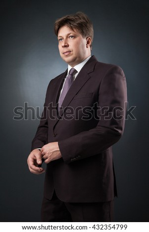 Portrait of serious businessman looking away
