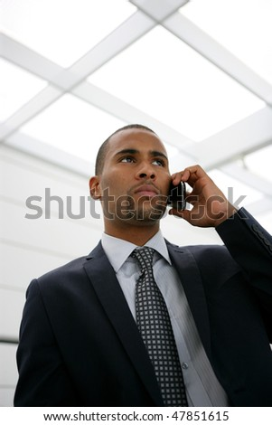 Portrait of serious businessman talking on the phone - stock photo