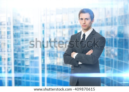 Portrait of serious businessman with crossed hands, blue background. Concept of leadership and success - stock photo