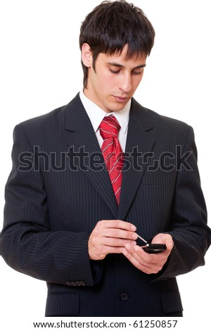 portrait of serious businessman with palmtop - stock photo