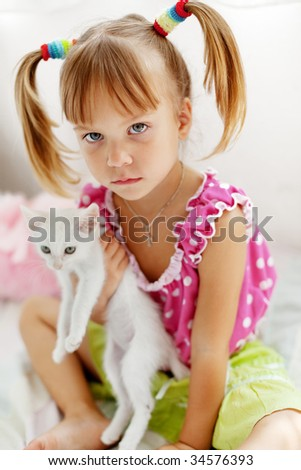 Portrait of serious child with kitten