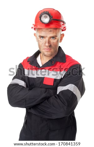 Portrait of serious coal miner with his arms crossed isolated on white background - stock photo