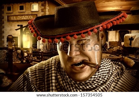 Portrait of serious cowboy mexican smoking cigar on a ranch at night - stock photo