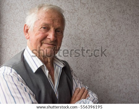 Portrait of serious elderly man of eighty years.