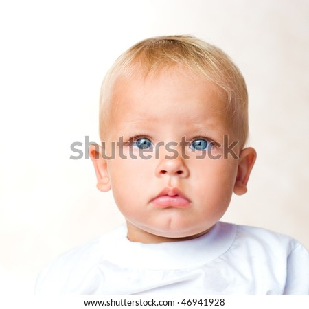 portrait of  serious kid is isolated on a white background