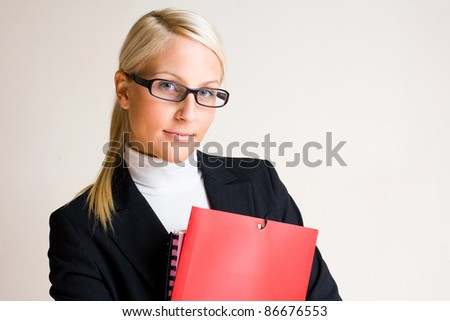 Portrait of serious looking business woman with folders isolated on white background. - stock photo