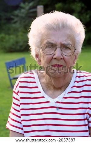 Portrait of serious senior citizen woman. - stock photo