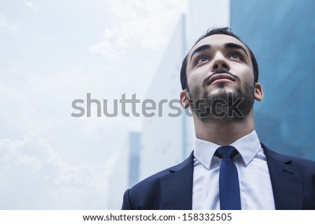 Portrait of serious young businessman - stock photo