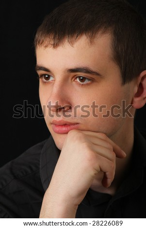 portrait of serious young man in shirt - stock photo