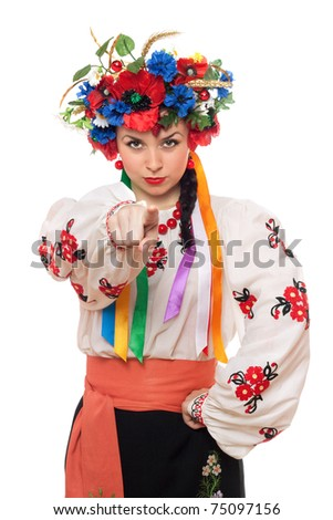 Portrait of serious young woman in the Ukrainian national clothes - stock photo