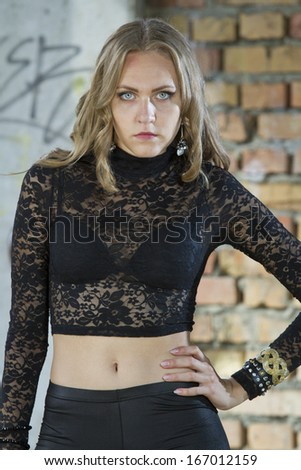 portrait of serious young woman outdoor - stock photo