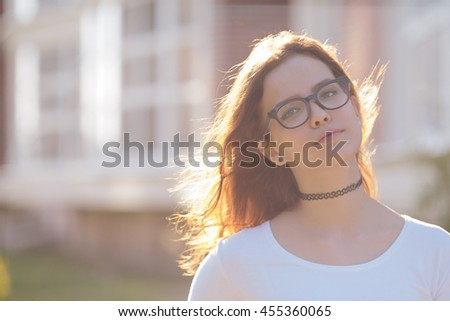 Portrait of serious young woman student girl wearing glasses - stock photo