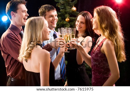 Portrait of several friends making a clink of bocals of champagne - stock photo