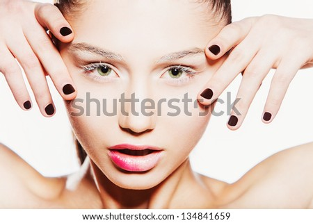 Portrait of sexy attractive glamour woman. Close-up face with fashion make-up. dark nails. - stock photo