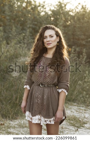 Portrait Of Sexy Beautiful Brunette Woman Wearing A Country Rustic Style Clothes Outdoors