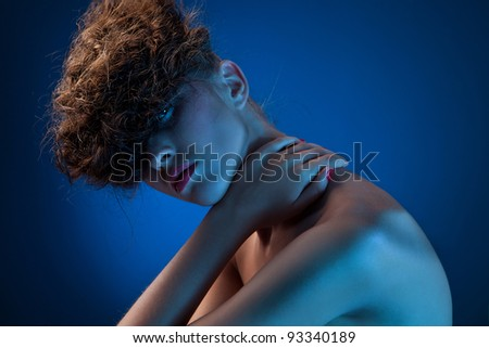 Portrait of sexy beautiful woman on dark blue background - stock photo