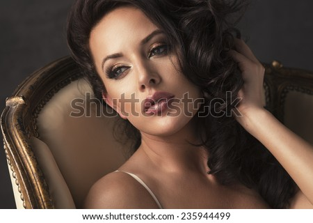 Portrait of sexy beautiful woman with long curly hair. Perfect makeup.  - stock photo
