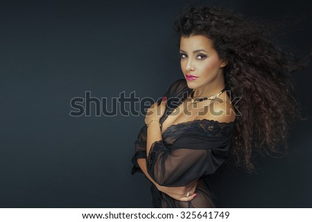 Portrait of sexy brunette african american woman with glamour makeup and long healthy hair. - stock photo
