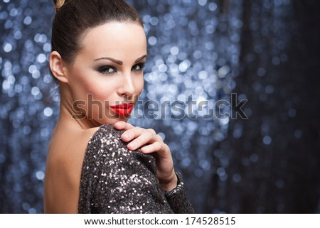 Portrait of sexy brunette dressed up for celebration. - stock photo