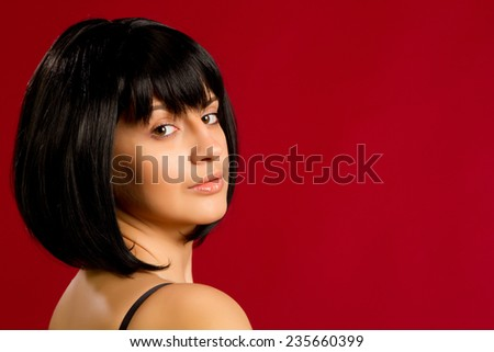 Portrait of sexy brunette on red background in studio - stock photo