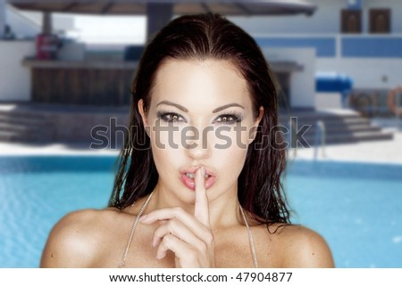 portrait of sexy brunette woman on the swimming pool - stock photo