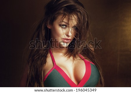 Portrait of sexy brunette woman with long hair and fashionable lingerie. Lady looking at camera. - stock photo