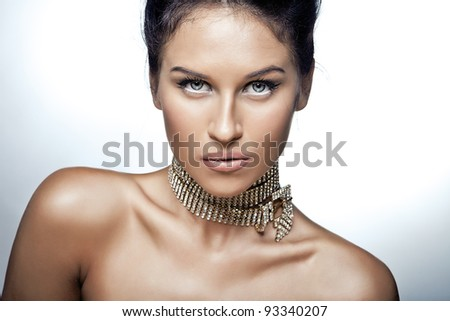 Portrait of sexy caucasian young woman with beautiful blue eyes posing on white background - stock photo