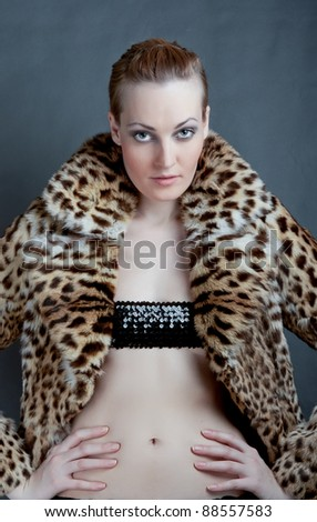 Portrait of sexy female in fashionable coat