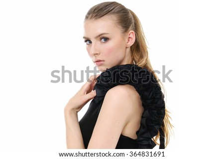Portrait of sexy girl in black dress posing