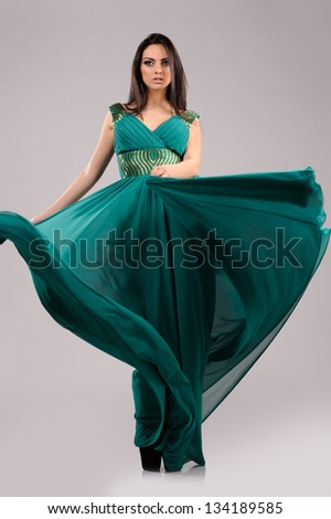 portrait of sexy girl  in green dress on gray background - stock photo