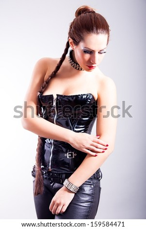 portrait of sexy girl wearing leather corset