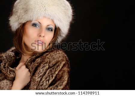portrait of sexy girl with hat on black background