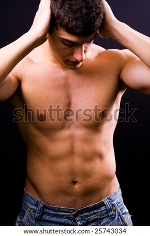 Portrait of sexy handsome muscular young man - stock photo