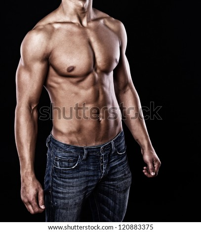 Portrait of sexy muscle man posing in studio - stock photo