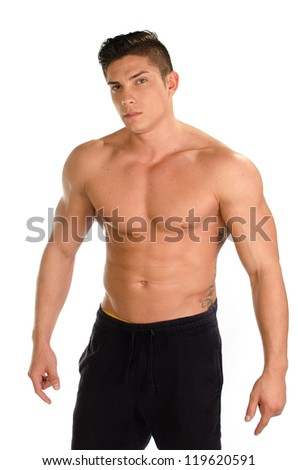 Portrait of sexy muscular man against white background