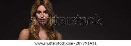 Portrait of sexy naked woman with long blond hair - stock photo