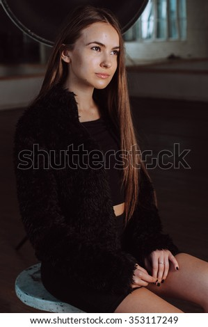 portrait of sexy natural beautiful model girl with long gorgeous hair posing in the studio
