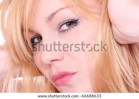 Portrait of sexy playful young blond Isolated