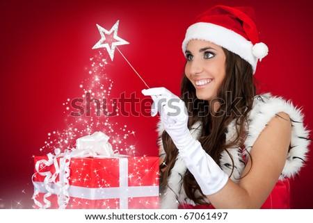 portrait of sexy santas helper with magic wand - stock photo
