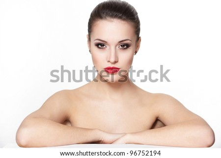 portrait of sexy serious sitting caucasian young woman model with glamour red lips,bright makeup, eye arrow makeup, purity complexion. Perfect clean skin - stock photo