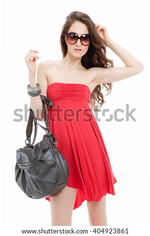 Portrait of sexy slim girl wearing red dress with sunglasses posing - stock photo