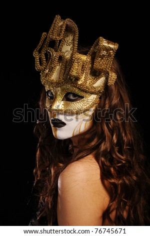 portrait of sexy woman in golden party mask isolated on black - stock photo