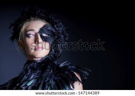 portrait of sexy woman with black feather half mask for Venice desire concept - stock photo